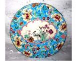 Ancienne assiette Longwy motifs échassiers